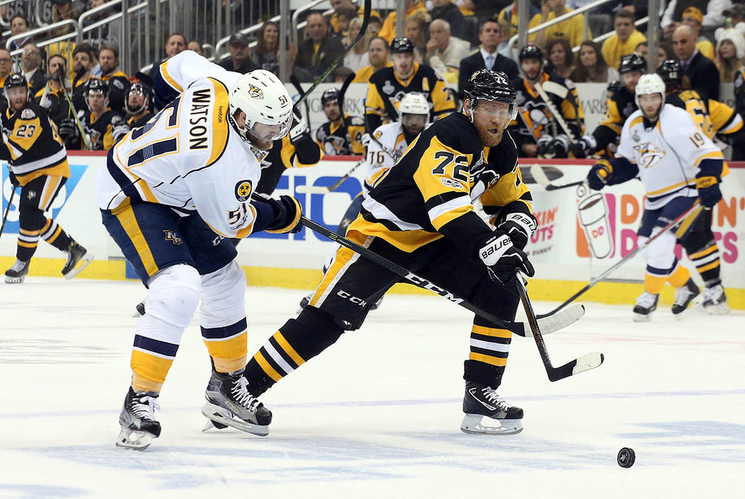 Pittsburgh Penguins right wing Patric Hornqvist (72) moves the puck ahead pf Nashville Predators left wing Austin Watson (51) during the first period in game five of the 2017 Stanley Cup Final at  ...