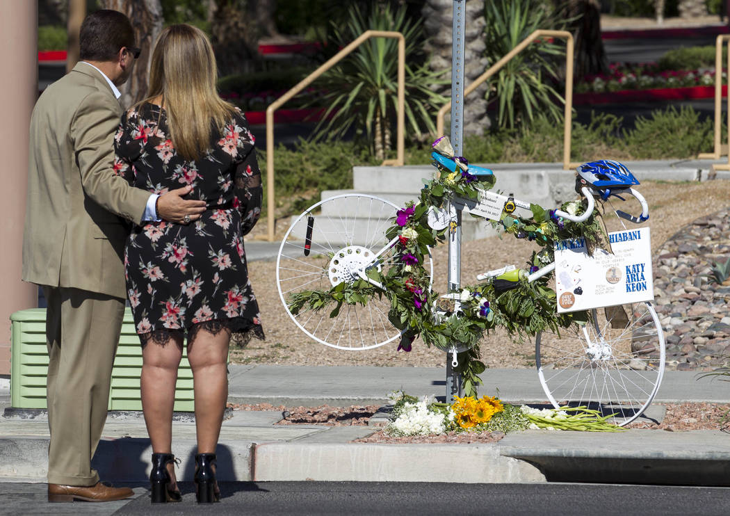 A couple stops at the ghost bike memorial of Dr. Kayvan Khiabani along South Pavillion Center Drive near West Charleston Boulevard on Saturday, June 17, 2017, in Las Vegas. Khiabani, 51, was kille ...
