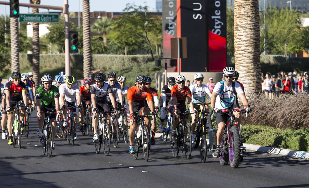 Pat Treichel, founder Ghost Bikes Las Vegas, leads a group ride in honor of Dr. Kayvan Khiabani along South Pavillion Center Drive near West Charleston Boulevard on Saturday, June 17, 2017, in Las ...