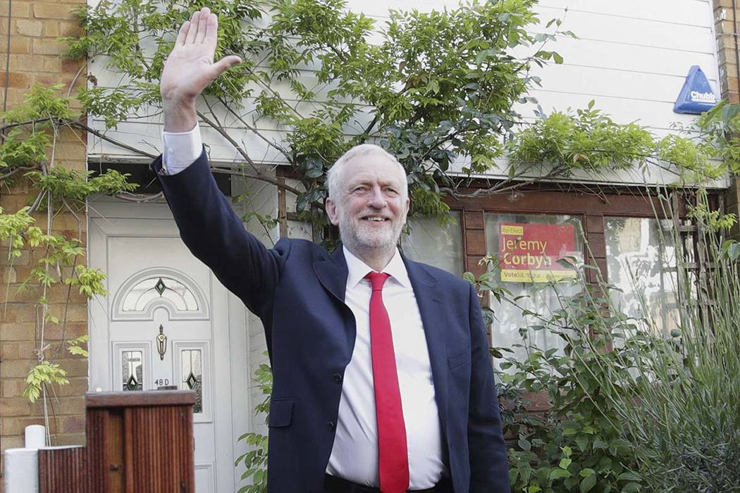 Labour leader Jeremy Corbyn waves as he leaves his home in north London, Friday June 9, 2017. British Prime Minister Theresa May's gamble in calling an early general election backfired spectacular ...