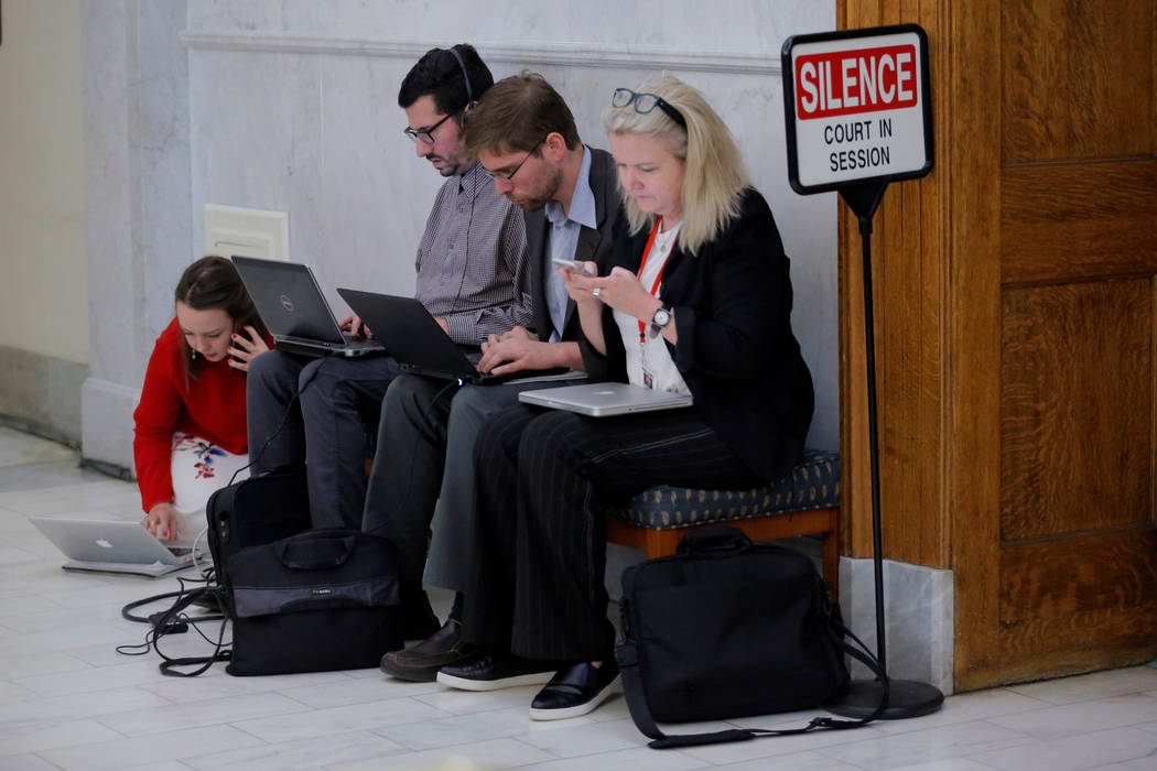 Journalists work during a break in the fifth day of Bill Cosby's sexual assault trial at the Montgomery County Courthouse in Norristown, Pennsylvania, June 9, 2017.  (Lucas Jackson/Reuters)