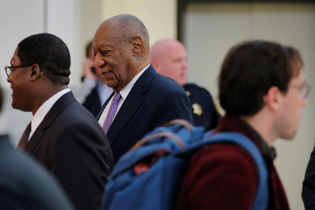 Actor and comedian Bill Cosby walks back into the courtroom after a break during the fifth day of Cosby's sexual assault trial at the Montgomery County Courthouse in Norristown, Pennsylvania, June ...