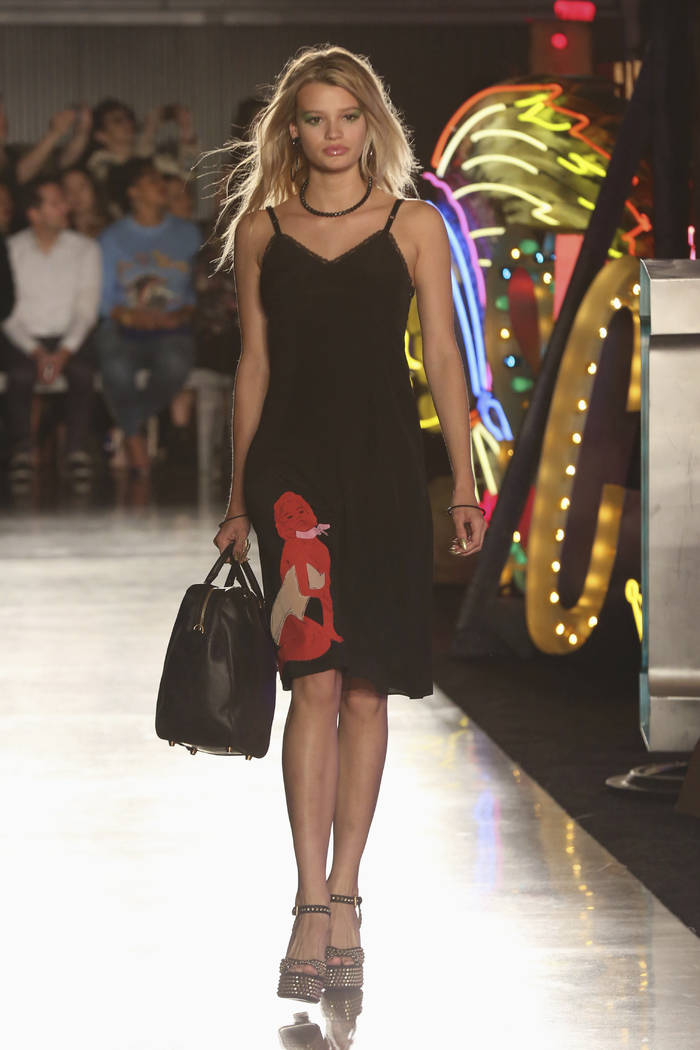 A model walks down the runway at the Moschino fashion show at MADE Fashion Festival on Thursday, June 8, 2017, in Los Angeles. Willy Sanjuan/Invision/AP)