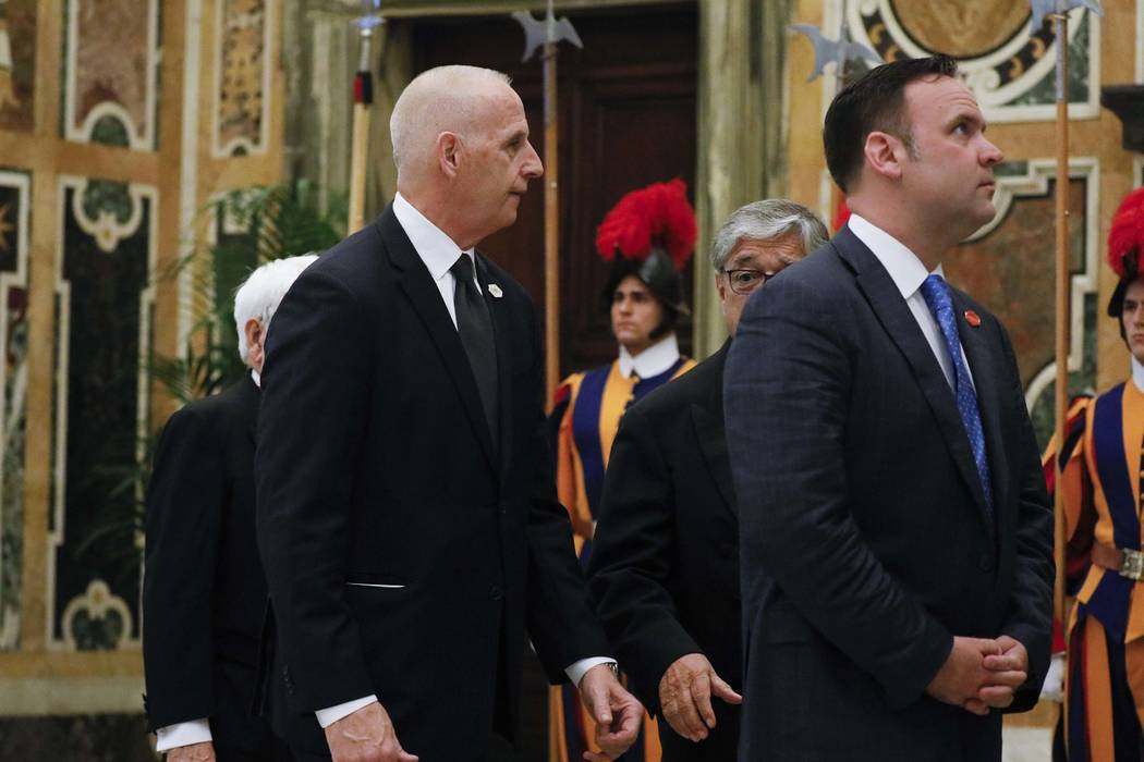 White House Director of Social Media Dan Scavino, right, and White House Director of Oval Office Operations Keith Schiller arrive to meet Pope Francis in a private audience, at the Vatican, Wednes ...