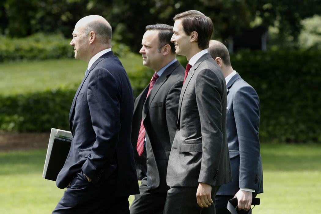 White House Director of Social Media, Daniel Scavino Jr., center, walks with National Economic Council chairman Gary Cohn and senior advisers Jared Kushner and Steven Miller to board the Marine On ...