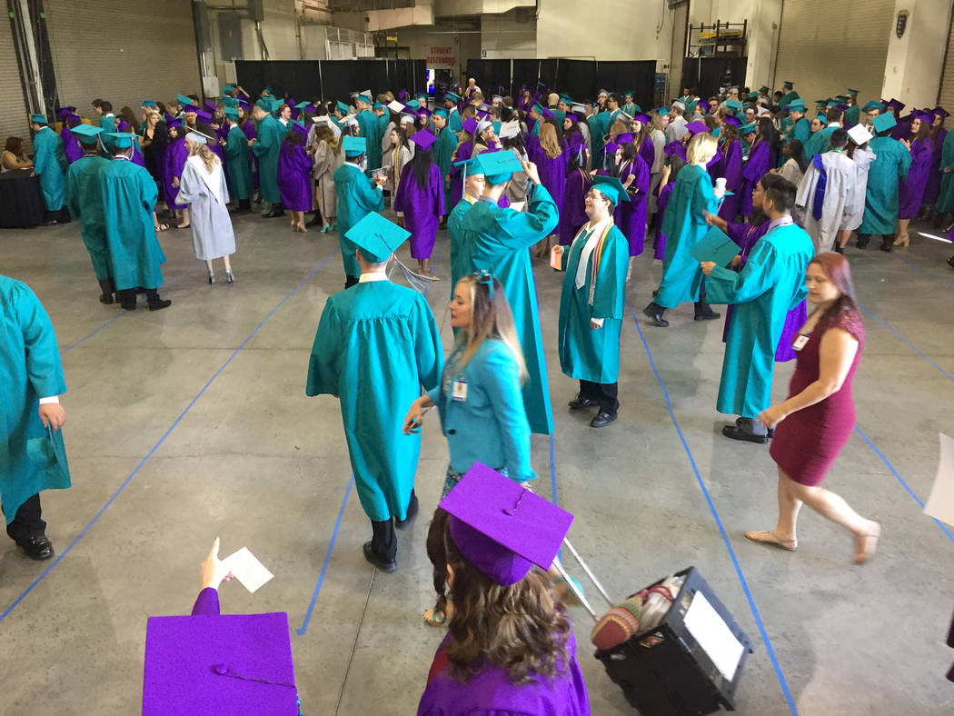 Silverado High School students congregate in a back room at Orleans Arena before graduation Wednesday morning. The arena will host 28 graduations this year. Meghin Delaney Las Vegas Review-Journal ...