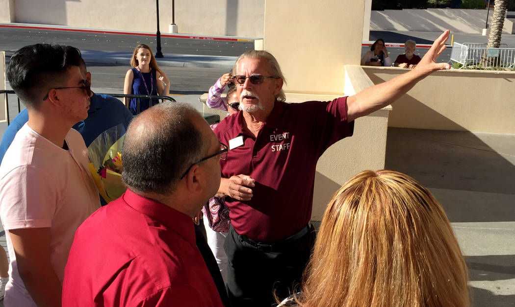 Usher Sonny Ruckrigl tells Silverado High School families the line into graduation will move faster if they each hold their own ticket. Families get about 10 tickets into the arena to watch gradua ...