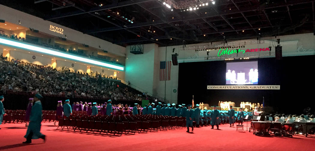 "Silverado High School students enter the Orleans Arena to ""Pomp and Circumstance"" Wednesday morning.The arena plays the theme song from ""Raiders of the Lost Ark&quot ..."