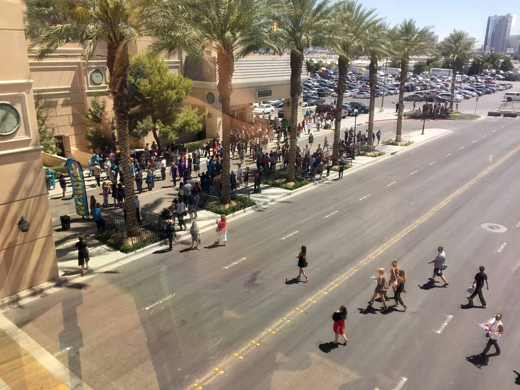 Families of Silverado High School graduates wait outside the Orleans Arena to find their students. Arena staff closed the area to vehicles for safety. Meghin Delaney Las Vegas Review-Journal @Megh ...