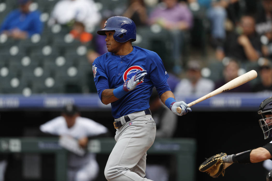 Chicago Cubs shortstop Addison Russell (27) in the ninth inning of the first baseball game of a doubleheader Tuesday, May 9, 2017, in Denver. The Rockies won 10-4. (AP Photo/David Zalubowski)