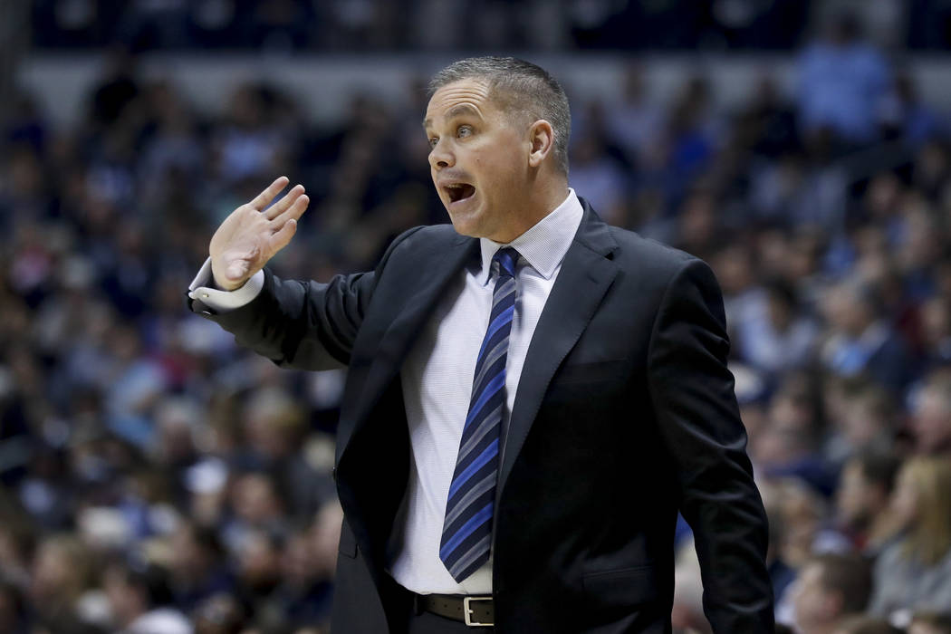 In this Feb. 26, 2017, file photo, Butler head coach Chris Holtmann directs his players from the bench in the second half of an NCAA college basketball game against Xavier in Cincinnati. Holtmann  ...