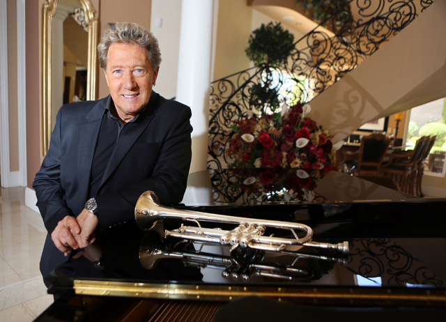 Greg Bonham stands near his trumpet and piano in his home east of The Lakes in Las Vegas in 2014. April 21. (Ronda Churchill/View)