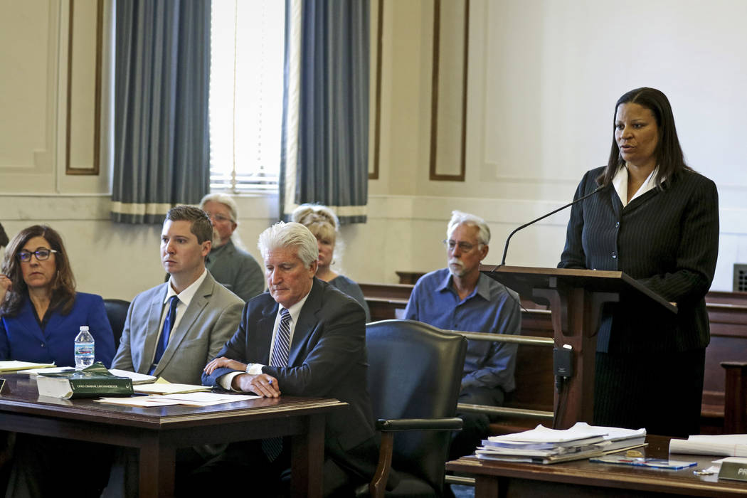 Assistant prosecutor Stacey DeGraffenreid, right, questions University of Cincinnati police Lt. Tim Barge after opening statements in the retrial of Ray Tensing, second from left, joined by defens ...