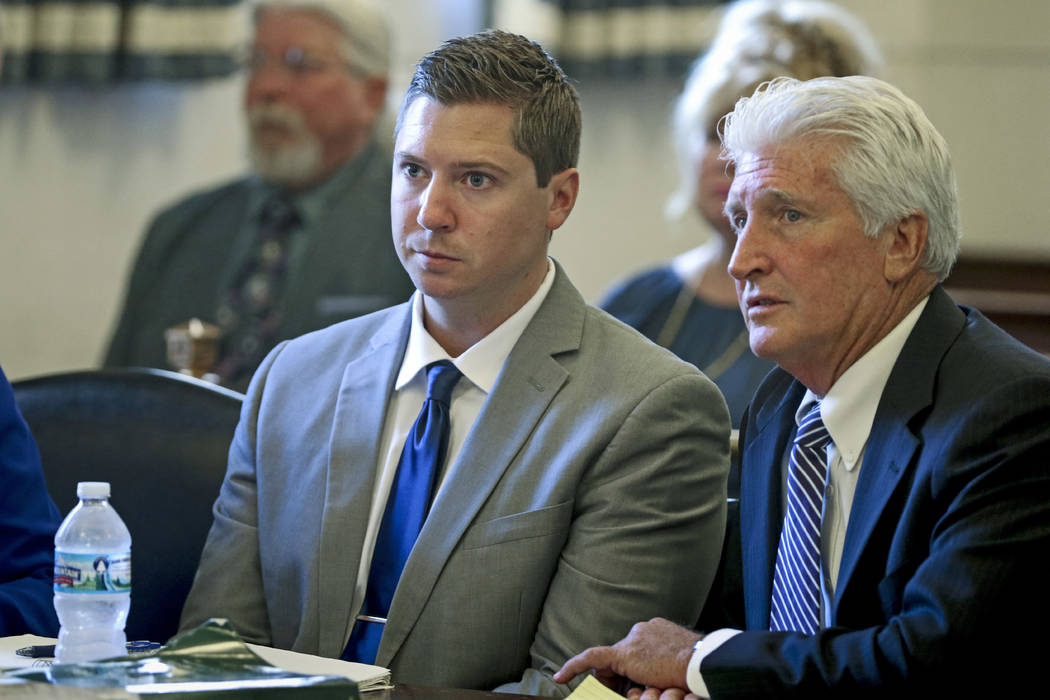 Ray Tensing, center, and his defense attorney Stewart Mathews, right, listen to assistant prosecutor Stacey DeGraffenreid's opening statement during Tensing's retrial Thursday, June 8, 2017, at th ...