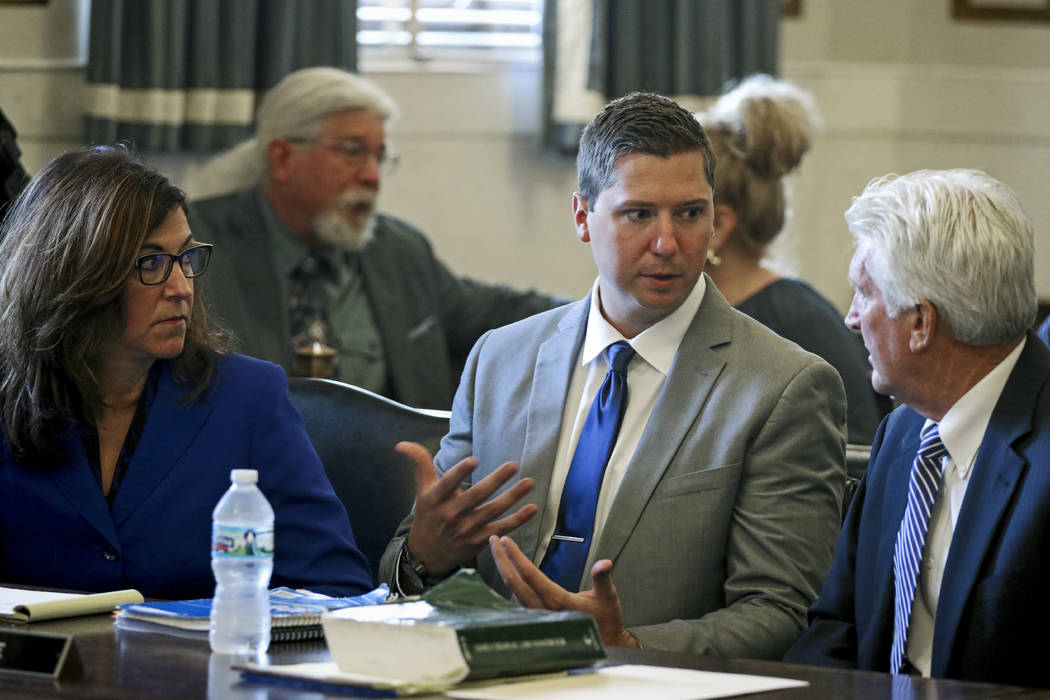 Ray Tensing, center, speaks to his defense attorney Stewart Mathews, right, before opening statements in Tensing's retrial Thursday, June 8, 2017, at the Hamilton County Courthouse in Cincinnati.  ...