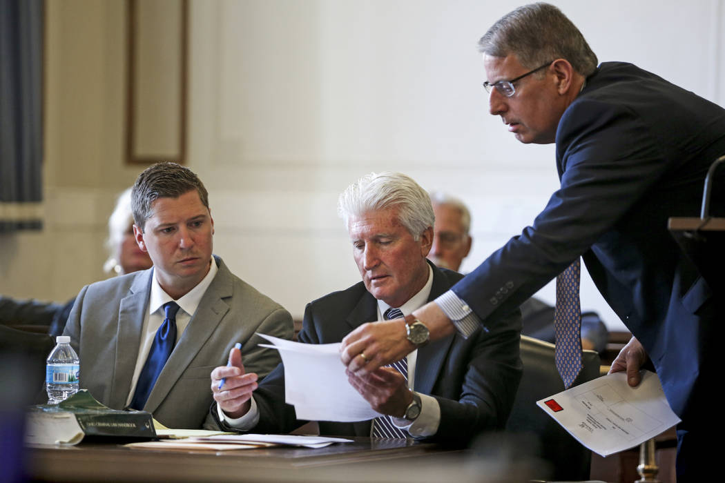 Assistant prosecutor Seth Tieger, right, shows documents to defense attorney Stewart Mathews, center, during the retrial of Ray Tensing, left, on Thursday, June 8, 2017, at the Hamilton County Cou ...