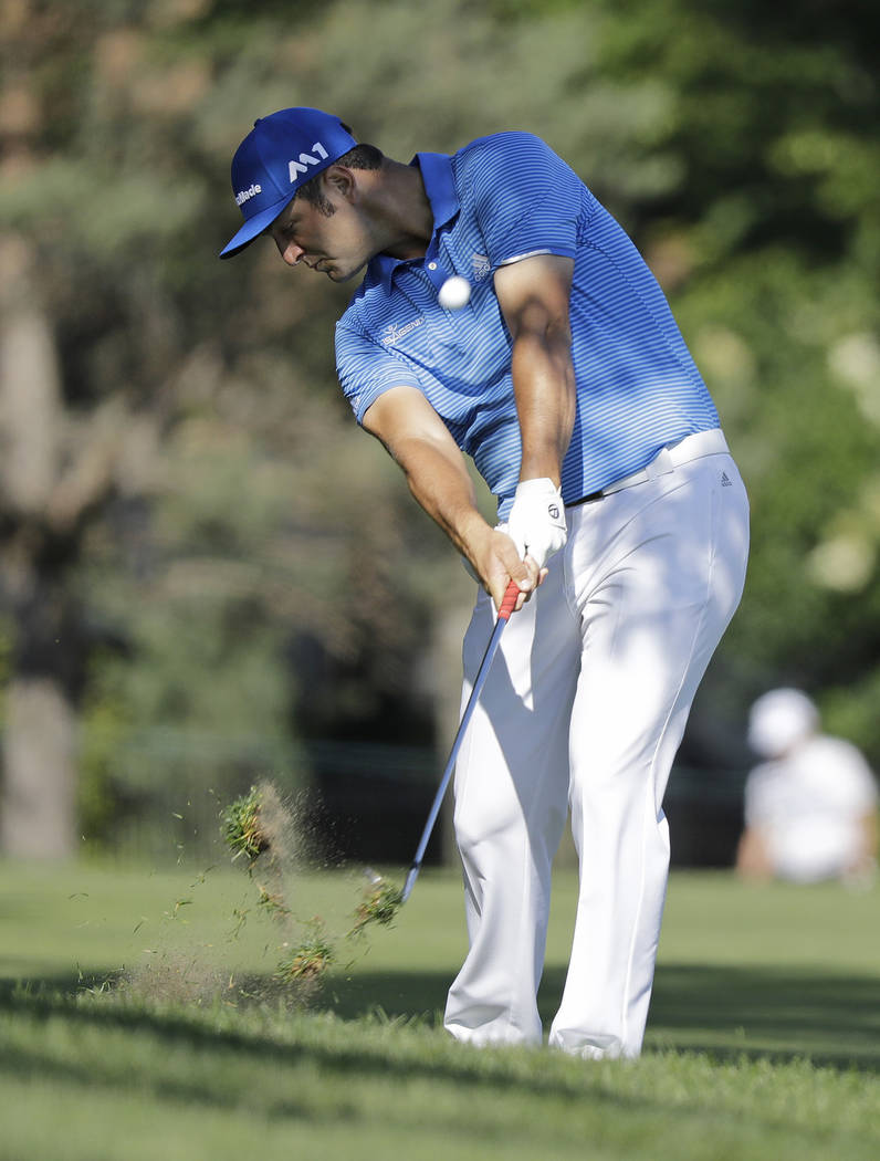Jon Rahm, of Spain, hits to the 13th green during the second round of the Memorial golf tournament, Friday, June 2, 2017, in Dublin, Ohio. (AP Photo/Darron Cummings)