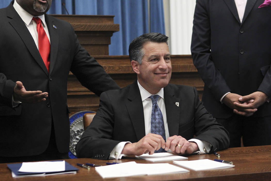Gov. Brian Sandoval before signing a group of bills while at the Nevada State Capitol Building in Carson City on Monday, June 5, 2017. Chase Stevens Las Vegas Review-Journal @csstevensphoto