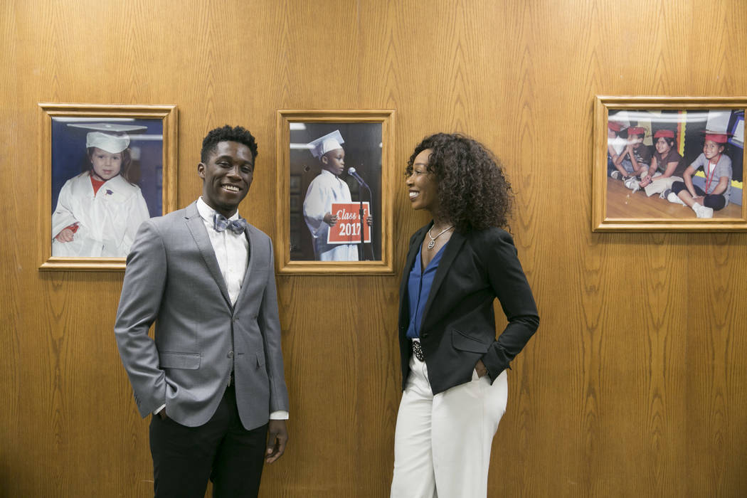 Valley High School graduate Niko Christian and his mom, Nyla Christian, with a photo showing him as a first-grader in the board room of the Clark County School District offices on Monday, June 12, ...