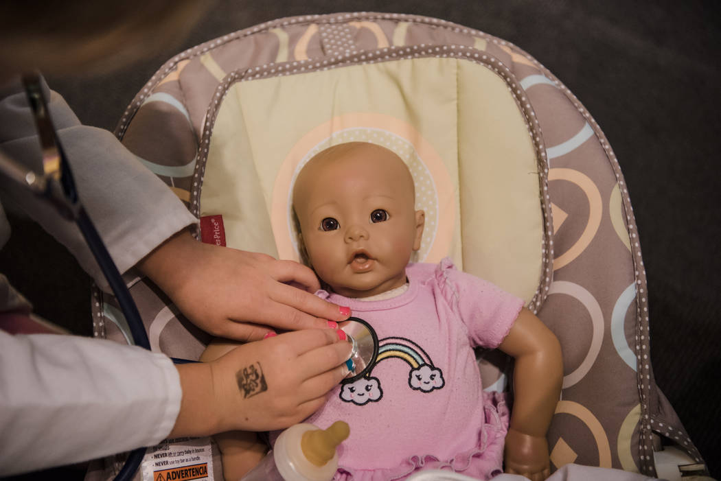 Keira O'Brien, 6, checks the baby doll's heartbeat in the doctor's office at the Discovery Children's Museum on Friday, June 9, 2017, in Las Vegas. Morgan Lieberman Las Vegas Review-Journal