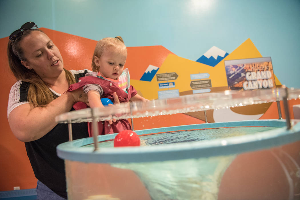 Kayla Gregory and daughter, Lailah Gregory, 18 months, play in the Water World room of the Discovery Children's Museum on Friday, June 9, 2017 in Las Vegas. Morgan Lieberman Las Vegas Review-Journal