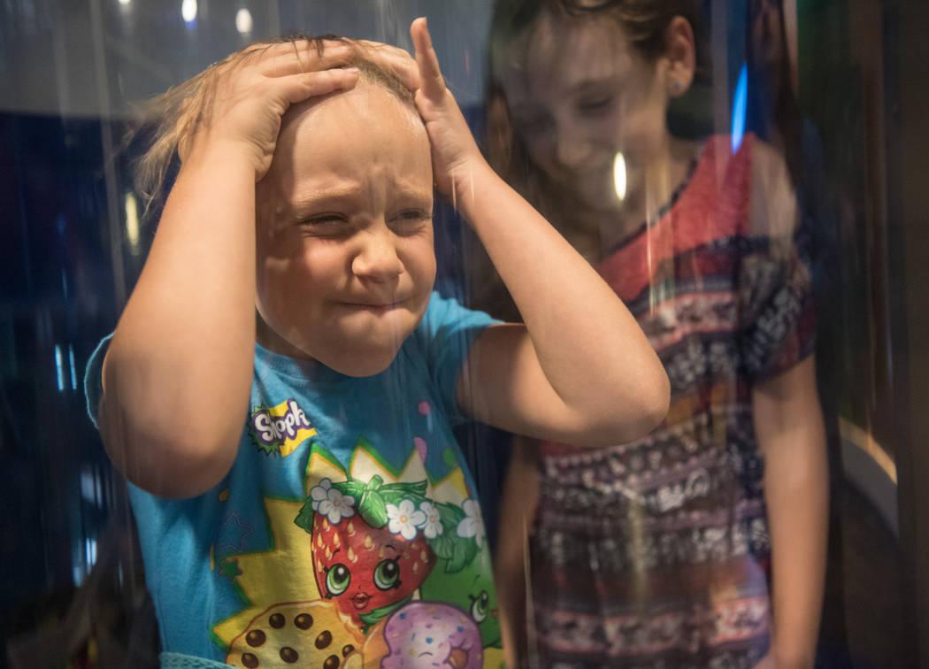 Amanda Pressman, 9, and Rachel Pressman, 6, take their turn in the hurricane simulator at Discovery Children's Museum on Friday, June 9, 2017 in Las Vegas. Morgan Lieberman Las Vegas Review-Journal