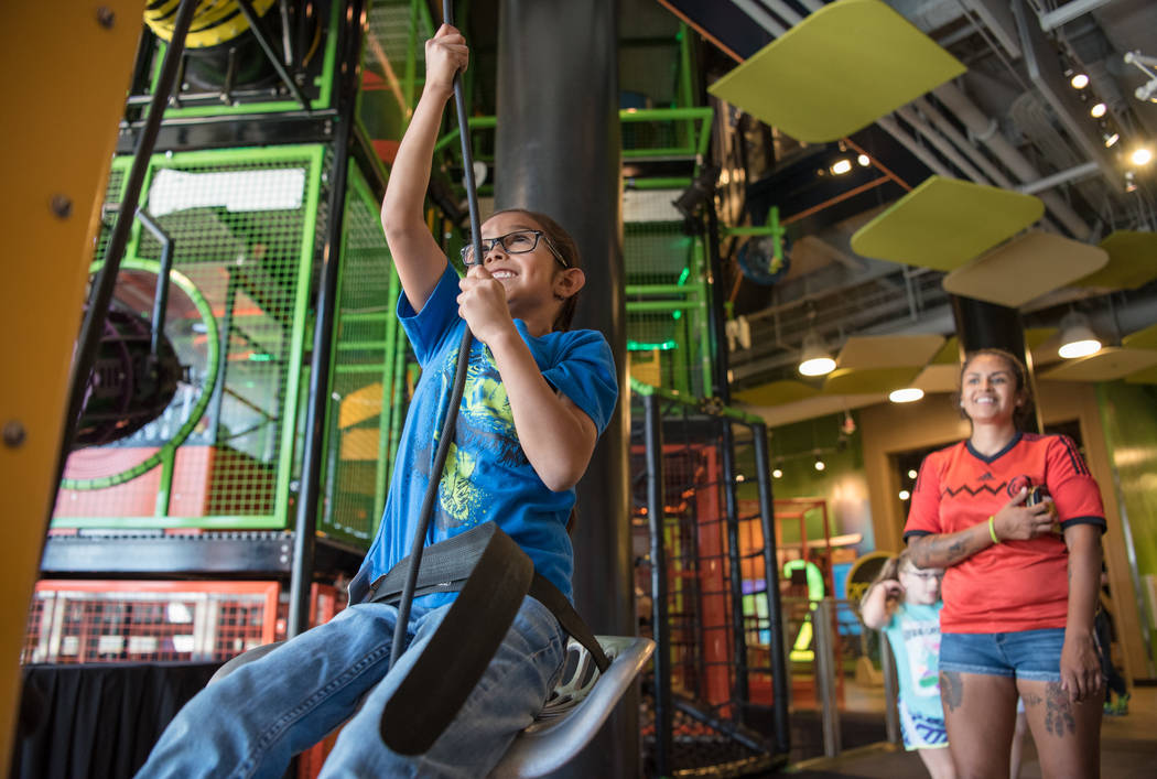 Itzia Lopez watches her daughter, Yoalli Martinez, 6, pull her weight to the top of a moving installation at Discovery Children's Museum on Friday, June 9, 2017, in Las Vegas. Morgan Lieberman Las ...