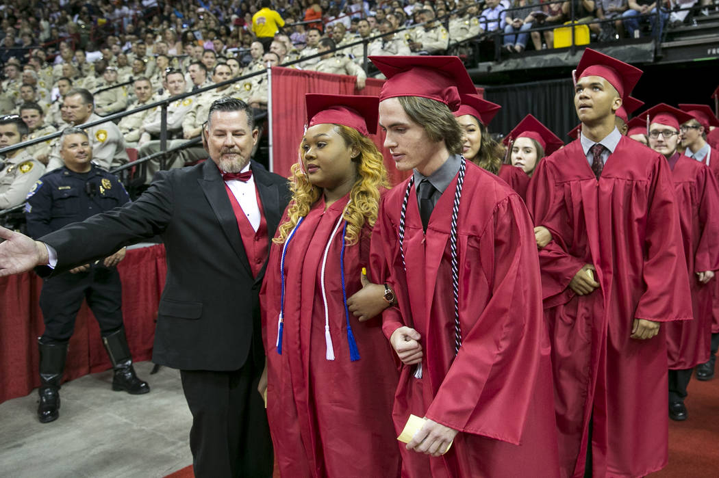 Daxton Beck, the son of slained Metro Officer Alyn Beck, and a classmate during his graduation ceremony at Thomas and Mack in Las Vegas on Saturday, June 10, 2017. Richard Brian Las Vegas Review-J ...