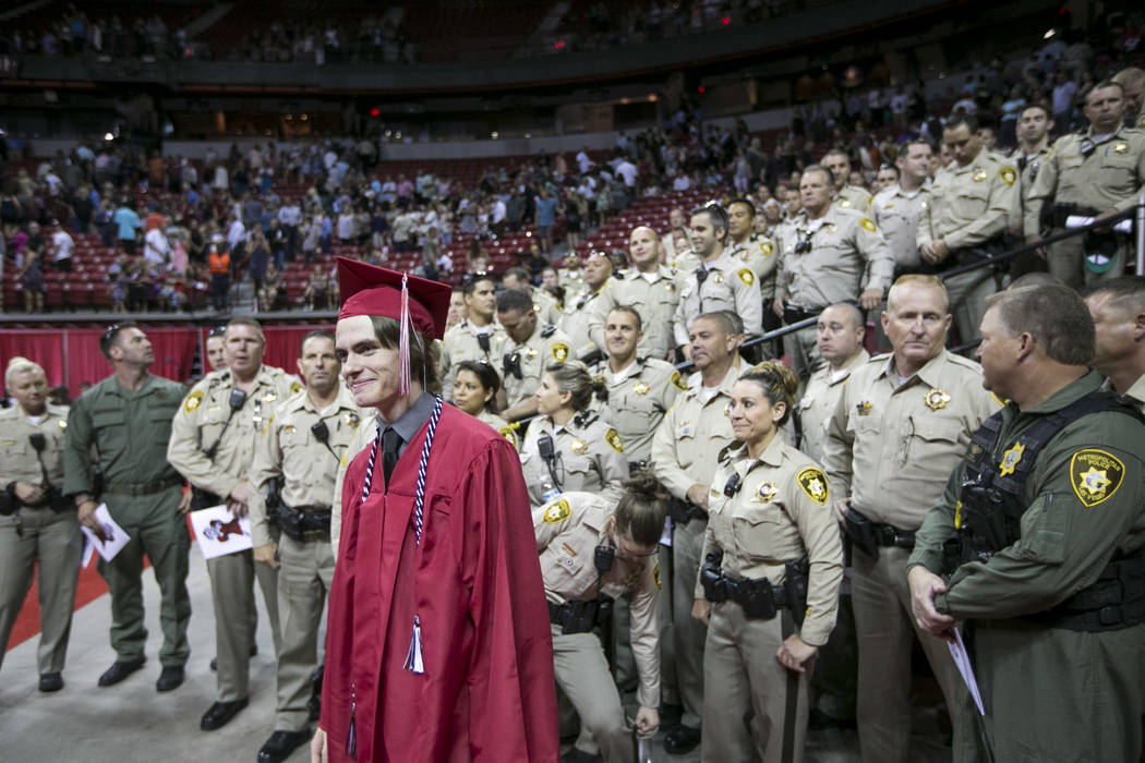 Daxton Beck, the son of slained Metro Officer Alyn Beck, gathers for photos with Metro Officers following his graduation ceremony at Thomas and Mack in Las Vegas on Saturday, June 10, 2017. Richar ...