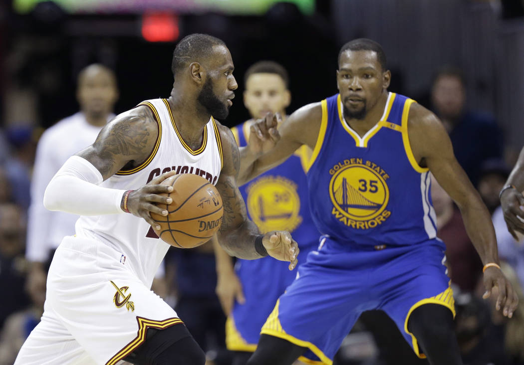 Cleveland Cavaliers forward LeBron James (23) drives on Golden State Warriors forward Kevin Durant (35) during the second half of Game 4 of basketball's NBA Finals in Cleveland, Friday, June 9, 20 ...