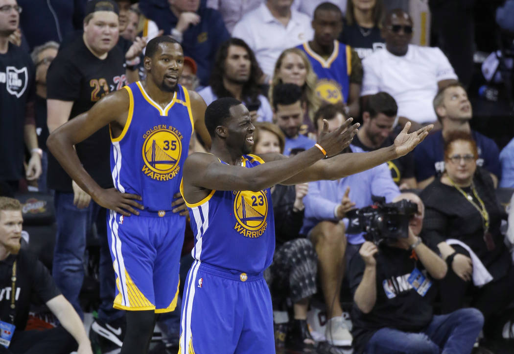 Golden State Warriors forward Draymond Green (23) gestures to fans during the second half against the Cleveland Cavaliers in Game 4 of basketball's NBA Finals in Cleveland, Friday, June 9, 2017. ( ...