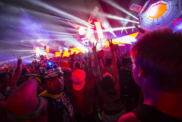 Attendees dance to music at the BassPod stage during the first night of Electric Daisy Carnival at the Las Vegas Motor Speedway in Las Vegas during the early hours of Saturday, June 18, 2016. Chas ...