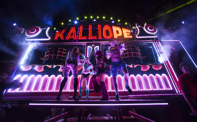 """Attendees dance by the Kalliope """"art car"""" during the first night of Electric Daisy Carnival at the Las Vegas Motor Speedway in Las Vegas during the early hours of Saturday, June 18, 2016. Chase St ..."""