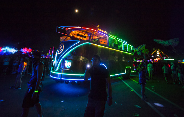 """A neon-lined """"art car"""" makes its way through the festival grounds during the first night of Electric Daisy Carnival at the Las Vegas Motor Speedway in Las Vegas on Friday, June 17, 2016. Chase Ste ..."""