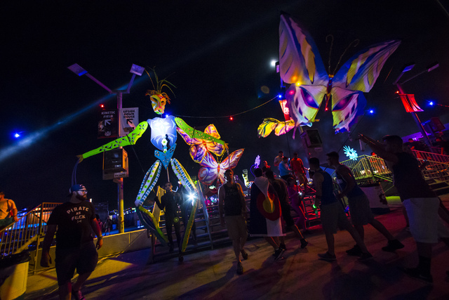 Attendees and costumed performers walk the festival grounds on the first night of Electric Daisy Carnival at the Las Vegas Motor Speedway in Las Vegas on Friday, June 17, 2016. Chase Stevens/Las V ...