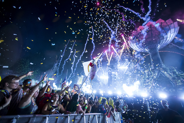Attendees dance to Dada Life as confetti falls at the Kinetic Field stage during the first night of Electric Daisy Carnival at the Las Vegas Motor Speedway in Las Vegas in the early hours of Satur ...