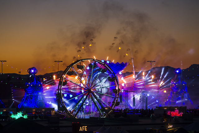 The sun rises as W&W performs at the Kinetic Field stage during the first night of Electric Daisy Carnival at the Las Vegas Motor Speedway in Las Vegas in the early hours of Saturday, June 18, ...