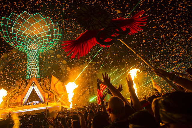Attendees dance to W&W at the Kinetic Field stage during the first night of Electric Daisy Carnival at the Las Vegas Motor Speedway in Las Vegas in the early hours of Saturday, June 18, 2016.  ...