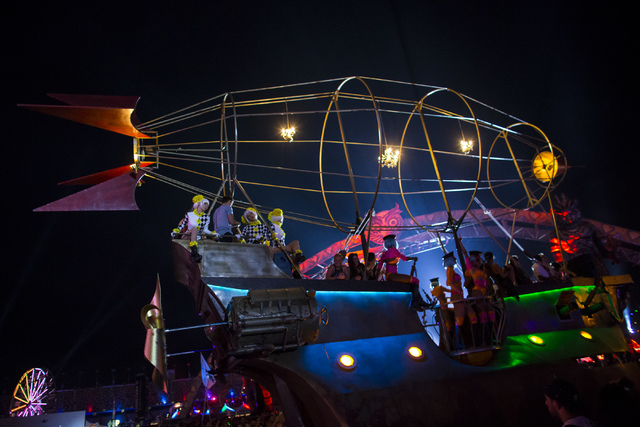"""An """"art car"""" drives through the festival grounds during the first night of Electric Daisy Carnival at the Las Vegas Motor Speedway in Las Vegas during the early hours of Saturday, June 18, 2016. C ..."""