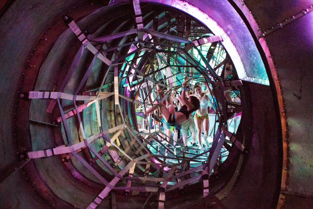 Attendees partake in an elaborate rope course on the third night of Electric Daisy Carnival at Las Vegas Motor Speedway early Sunday night, June 19, 2016. (Elizabeth Brumley//Las Vegas Review-Jour ...