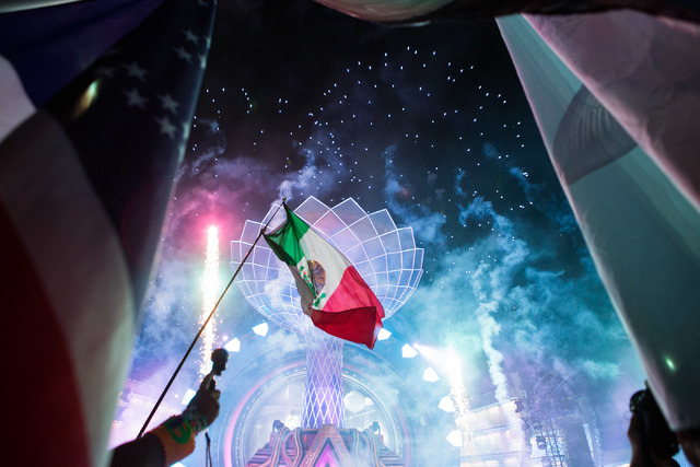 Fireworks and flags fill the sky as artist DJ Carnage dedicated his last song to minorities, especially the Latino community on the third night of Electric Daisy Carnival at Las Vegas Motor Speedw ...