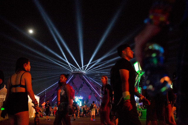 The stage Neon Garden is lit up as attendees walk from one activity to another under the full moon on the third night of Electric Daisy Carnival at Las Vegas Motor Speedway early Monday morning, J ...