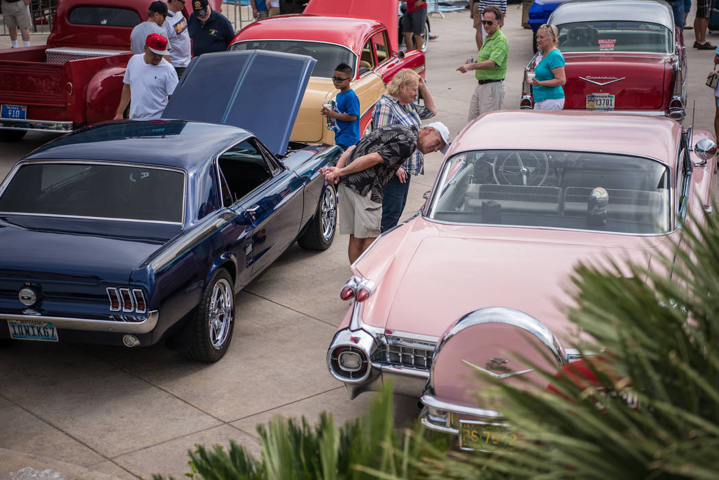 Mark and Jamie Robinson take a look at a vintage pink Cadillac at the Beers, Gears & Bikinis Car Show,  held at the M Resort on Saturday, June 10, 2017, in Las Vegas. The event featured over 4 ...