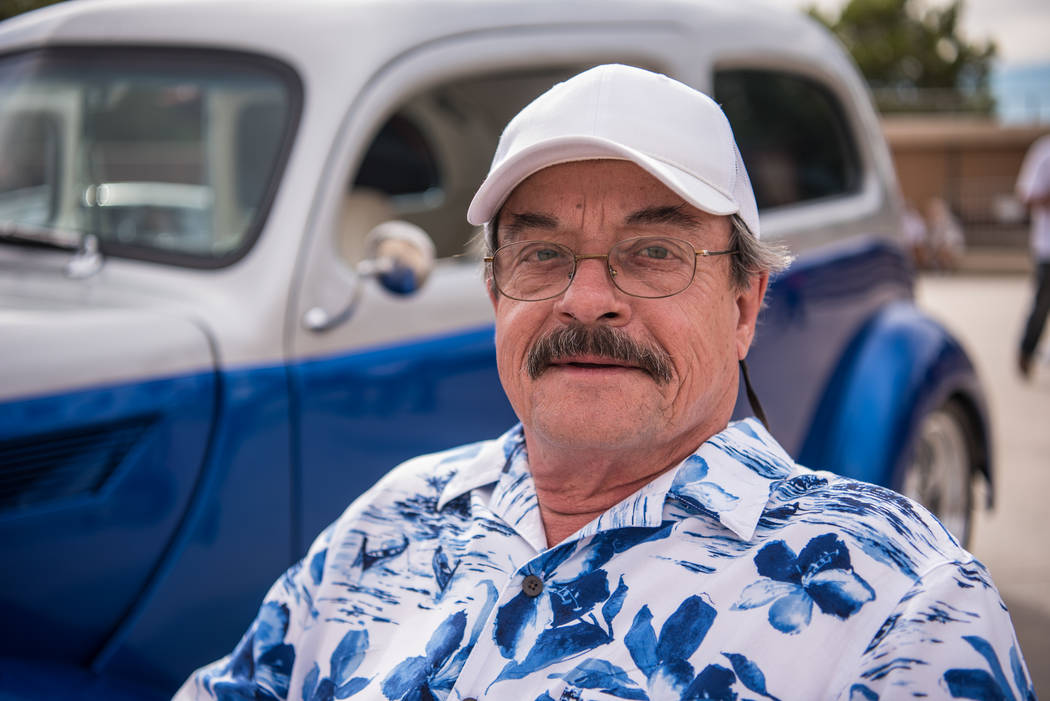Milan R. Mlaker, owner of a blue 1937 Ford 2-door Slantback, poses for a portrait at the Beers, Gears & Bikinis Car Show held at the M Resort on Saturday, June 10, 2017, in Las Vegas. The even ...