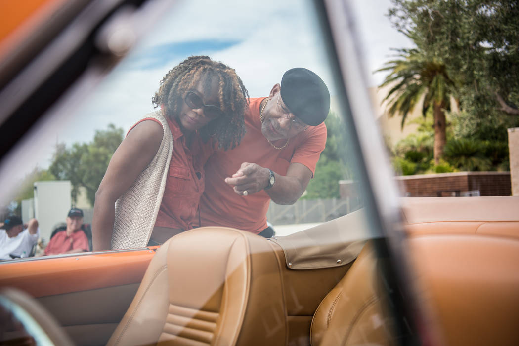 Denise Frelot and Frank Sweet check out the interior of a vintage car on display at the Beers, Gears & Bikinis Car Show at the M Resort on Saturday, June 10, 2017, in Las Vegas. The event feat ...
