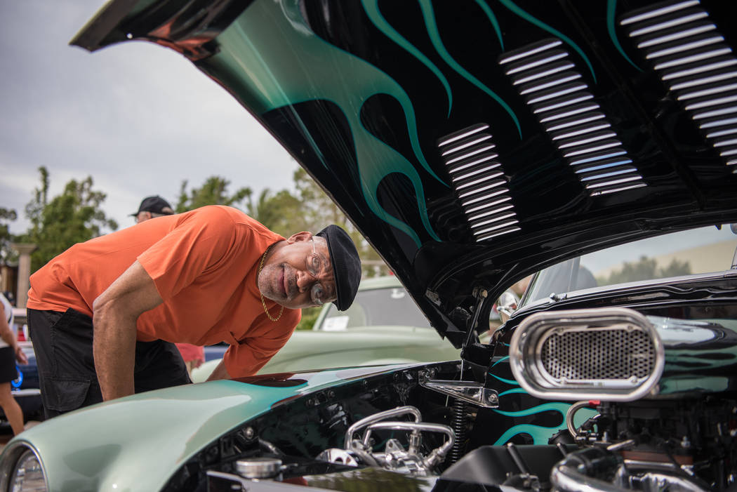 Frank Sweet checks out the hood of a vintage car on display at the Beers, Gears & Bikinis Car Show at the M Resort on Saturday, June 10, 2017, in Las Vegas. The event featured over 40 cars in  ...