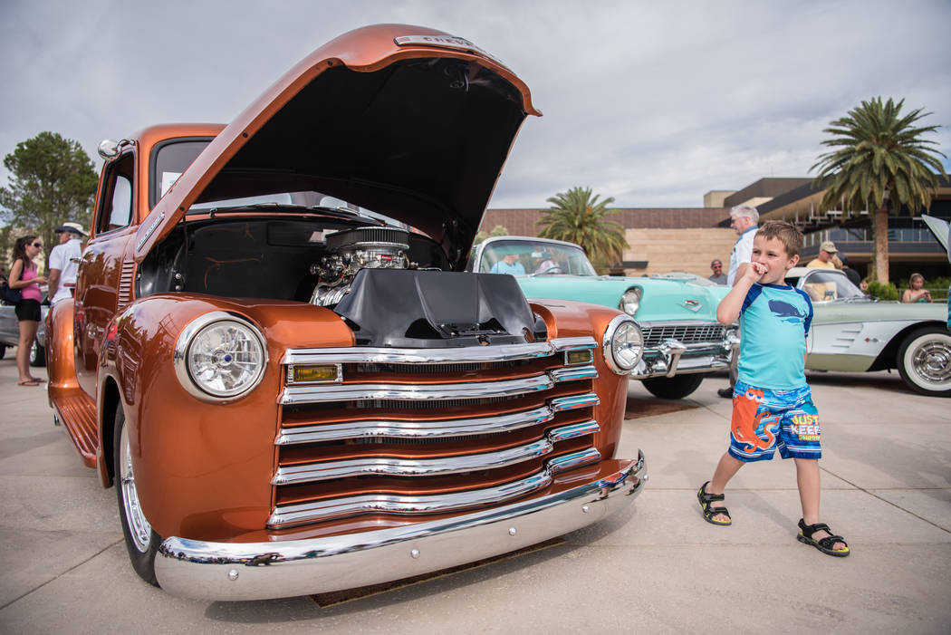 Jackson Rios, 6, brushes past a 1952 Chevy at the Beers, Gears & Bikinis Car Show held at the M Resort on Saturday, June 10, 2017, in Las Vegas. The event featured over 40 cars in competition. ...