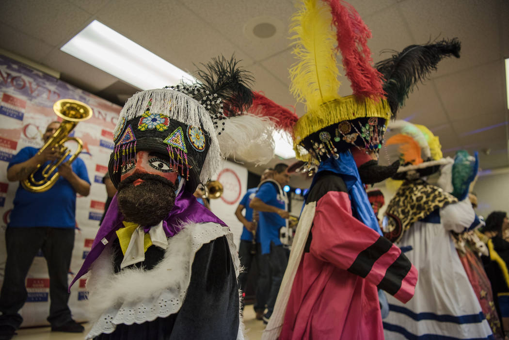 "Fiesta Moralense, a dance group dedicated to ""Los Chinelos,"" takes the elevator upstairs to the ""I Am An Immigrant"" celebration event at the Asian Culture Allia ..."