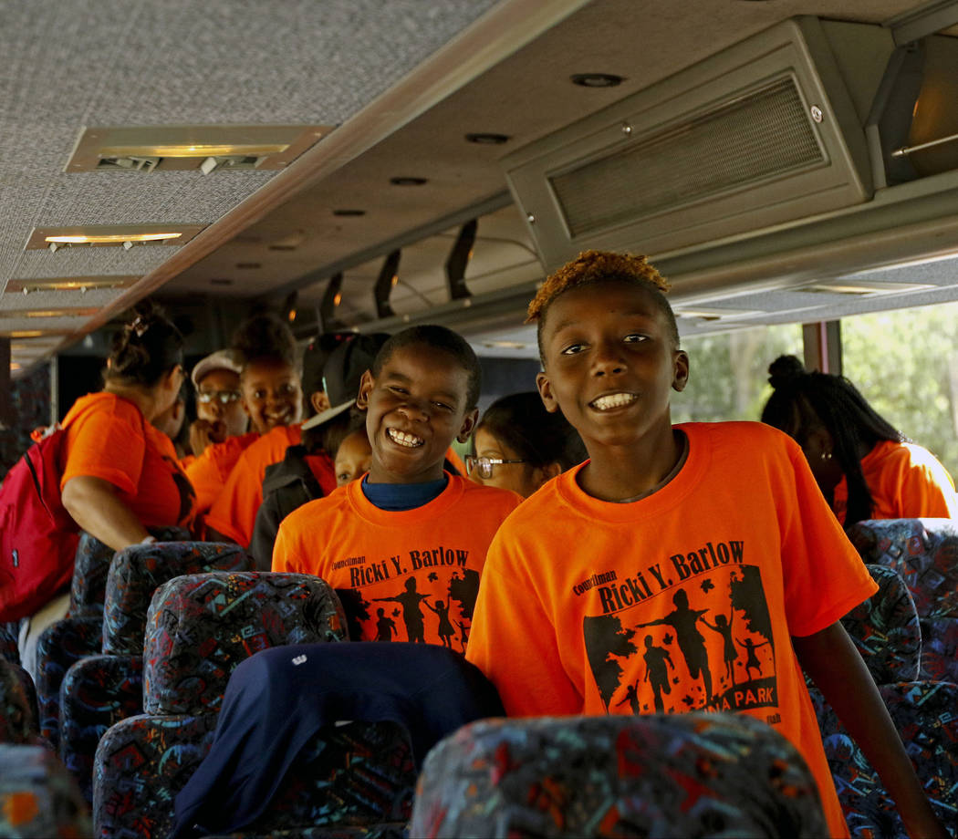 Fourth graders from Wendell P. Williams Elementary School and Victory Mission Baptist Church excitedly walk off their bus into Zion National Park, Saturday, June 10, 2017. One hundred fifty childr ...