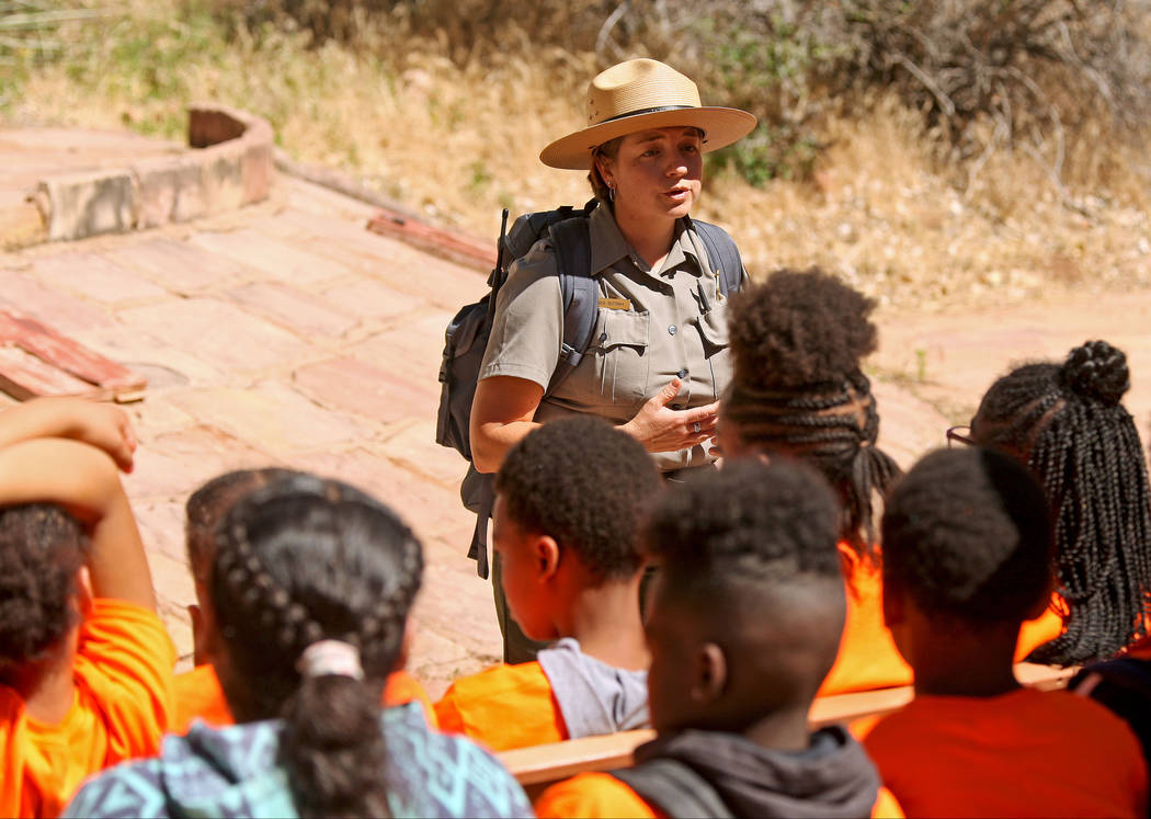 "Park Ranger Andi Buttram gives a brief speech at Zion National Park during the ""1 Million African American Youth In A Park"" program, Saturday, June 10, 2017. One hundred fifty ch ..."